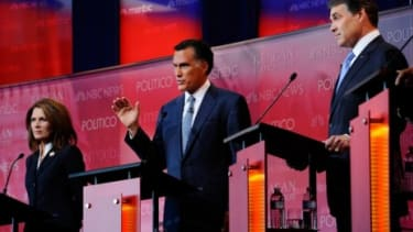 Wednesday's GOP debate marked the first time in the young campaign season that Mitt Romney and Rick Perry shared the stage, and they didn't hesitate long before trading rhetorical blows.