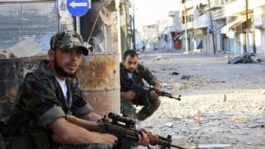 Free Syrian Army fighters patrol a street near Homs, May 5, 2012: The U.N.'s 300-member observer mission has been suspended due to increased violence.