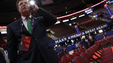 Paul Manafort takes a call at the Republican National Convention.