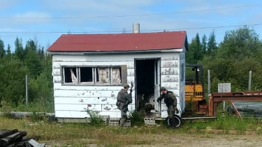Mounties search a cabin in Manitoba while searching for two murder suspects.