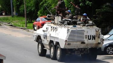 An armored UN truck patrols the streets in the Ivory Coast: President Laurent Gbagbo still refuses to cede power as violence continues.