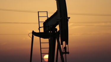 An oil pump works as the sun sets