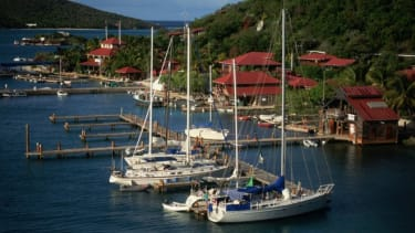 Behind this idyllic scene on the British Virgin Isle of Virgin Gorda, is a trove of offshore money.
