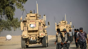 An armored vehicle with an American symbol on it drives near Mosul on Oct. 18.