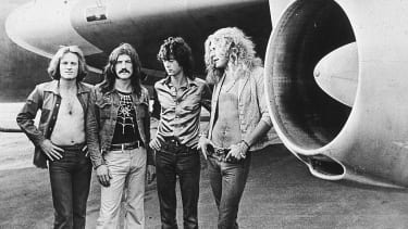 Led Zeppelin in front of an their private airliner The Starship, 1973.
