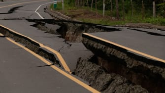 A cracked road from a 2016 earthquake in Ecuador