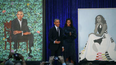 Barack and Michelle Obama stand by their portraits