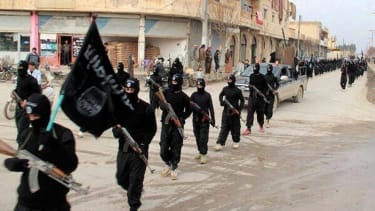 ISIS militants march in this file photo.