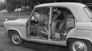 A demonstration of the efficacy of seat belts in 1960.