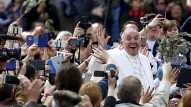 Pope Francis waves at fans after Sunday mass.