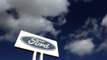 A Ford sign above a head office