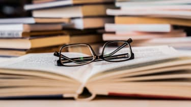 Reading glasses on top of a book.