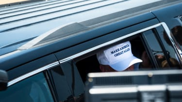 View of Donald Trump's hat as he exits his car.