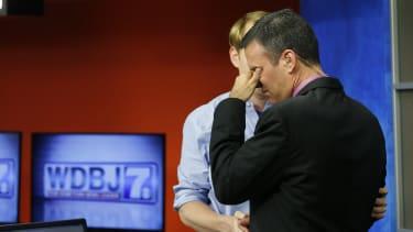 WDBJ-TV7 anchor Chris Hurst comforts meteorologist Leo Hirsbrunner.