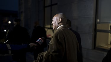 Bill Cosby leaves a courthouse