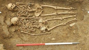Skeletons unearthed in England found holding hands