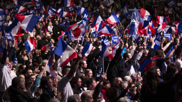 Marine Le Pen supporters wave French flags.