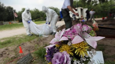 Researchers discover remains of would-be immigrants haphazardly buried in mass graves