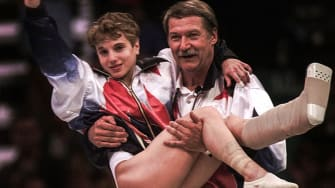 Kerri Strug is carried by her coach, Bela Karolyi, during the 1996 Olympics.