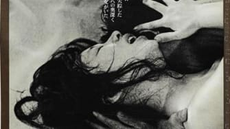 A movie poster for Woman in the Dunes