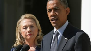 """President Obama, with Secretary of State Hillary Clinton, makes a statement about the death of U.S. ambassador to Libya Christopher Stevens on Sept. 12: """"The world must stand together to uneq"""