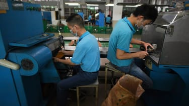 Men making shoes in factory.