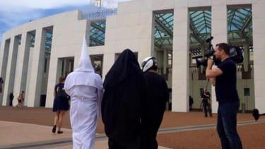Anti-burqa protesters don KKK hoods, biker helmets at Australian Parliament