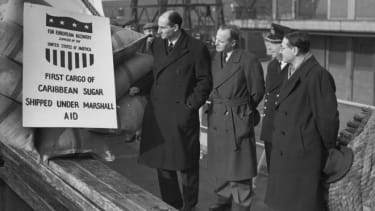 Dignitaries at the Royal Victoria Dock in London welcome the first shipment of Caribbean sugar made under the Marshall Plan.