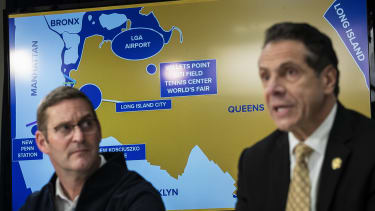 John Schoettler, Vice President for Global Real Estate at Amazon, and New York Governor Andrew Cuomo.