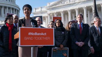 Lawmakers rally against travel ban.