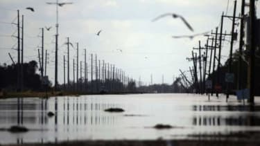 In Plaquemines Parish, La., birds fly on Sept. 2 above flooding caused by Hurricane Isaac: Hundreds of thousands of Pelican State residents are still without power.