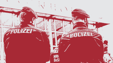 Police guard the train station in Cologne, Germany.