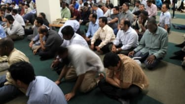Men attend Friday prayers at the proposed site of the highly controversial Park51 mosque and cultural center.