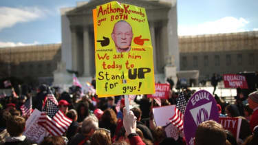 A sign depicting Justice Anthony Kennedy is housed outside the Supreme Court on March 27.
