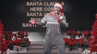 Watch The Rock karaoke 'Here Comes Santa Claus' in a onesie