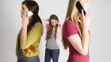 Looks like it OK to cozy up to those cell phones after a study out of Denmark find no link between long-term use and cancer.