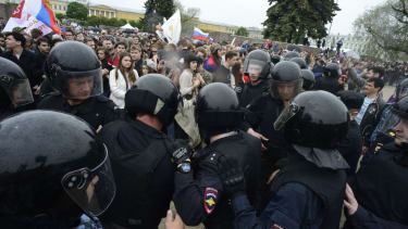 Russian police officers at opposition rally.