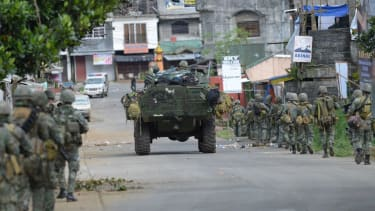 Government forces combat ISIS-linked rebels in the Philippines
