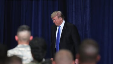 President Trump delivers a speech about Afghanistan in front of members of the military