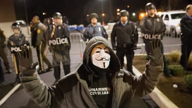 Brown family calls for peace as more authorities head to Ferguson