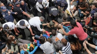 On Saturday, police arrest demonstrators affiliated with the Occupy Wall Street movement: Some commentators have compared the New York protest to the revolutionary demonstrations earlier this