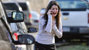 A woman waits to find out if her sister, a teacher at Sandy Hook Elementary is safe.