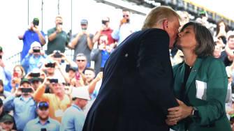 President Trump kisses Sen. Joni Ernst on the cheek.