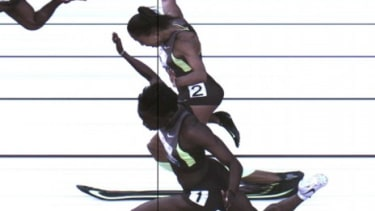 The third place photo-finish of the women's 100-meter final shows Allyson Felix and Jeneba Tarmoh (foreground) in a dead heat for the last spot on the U.S. Olympic team.