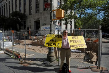 A protestor outside of the Epstein trial.