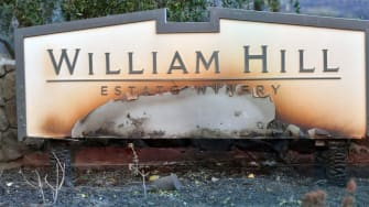 The partially destroyed William Hill Estate Winery sign.
