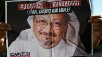 A person holds a picture of Jamal Khashoggi.