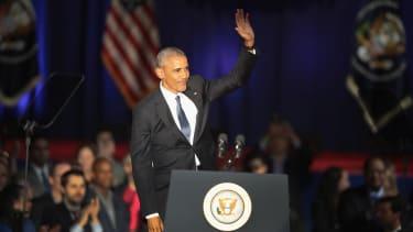 Barack Obama waves to crowds