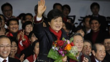 South Korean President-elect Park Geun-Hye celebrates with her historic win on Dec. 19.