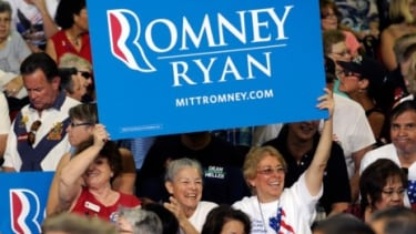 Supporters cheer for Mitt Romney during a campaign event in Las Vegas, Nev.